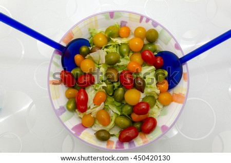 green salad with tomatoes of many colors - stock photo