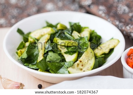 Green salad with zucchini, spinach, herb, spring fresh, healthy dish