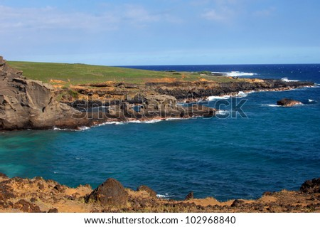Green sand beach, Big Island of Hawaii, has tremendous scenery of rocky monoliths and rugged seashore.  Aqua blue waters turn to deep blue as it nears the distant horizon.