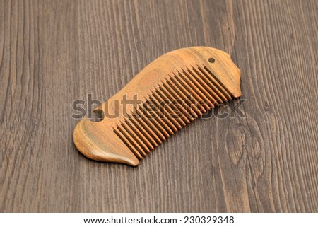 Green sandalwood comb on a wood background - stock photo