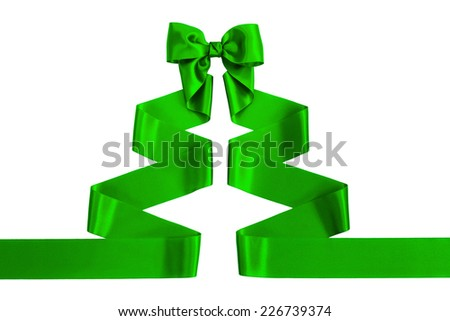 Green satin ribbon with bow shaped as a Christmas tree, isolated on white background - stock photo