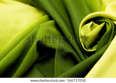 Green satin textile background (close up) - stock photo