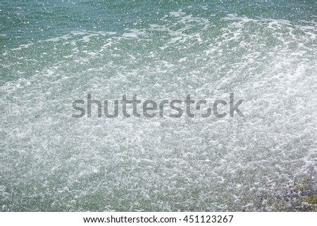 green sea water texture with water spray,select focus with shallow depth of field:ideal use for background