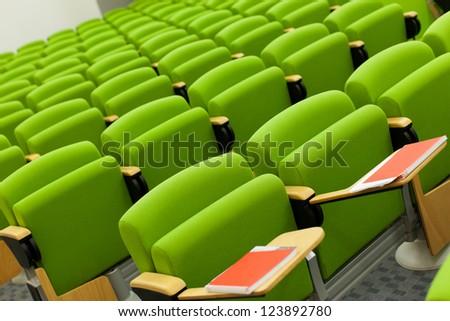 Green seats in big empty hall - stock photo
