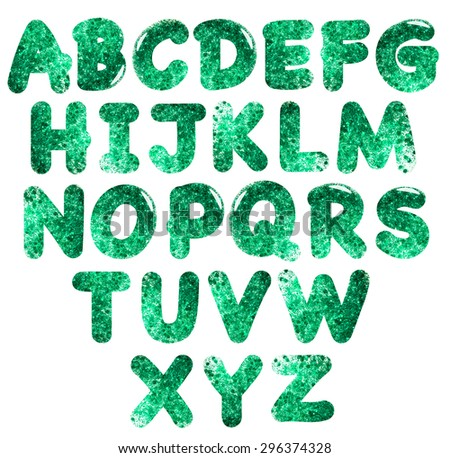 Green sequin alphabet. Photo.