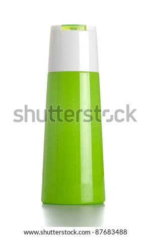 Green shampoo bottle on white isolated - stock photo