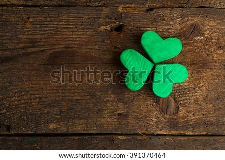 Green shamrock clovers on wooden background. Background for St. Patrick's Day celebration - stock photo