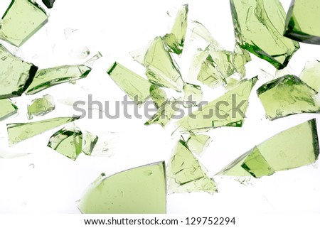 Green shards of glass isolated on white