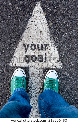 Green shoes standing on your goal sign - stock photo