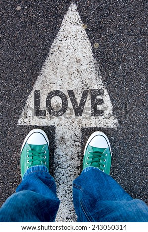 Green shoes standing on your love sign - stock photo