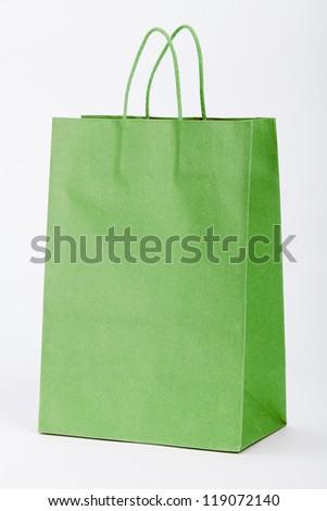 Green shopping bag on white. - stock photo