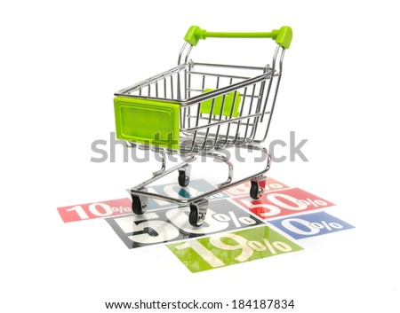 Green shopping cart on percentage adverts - stock photo