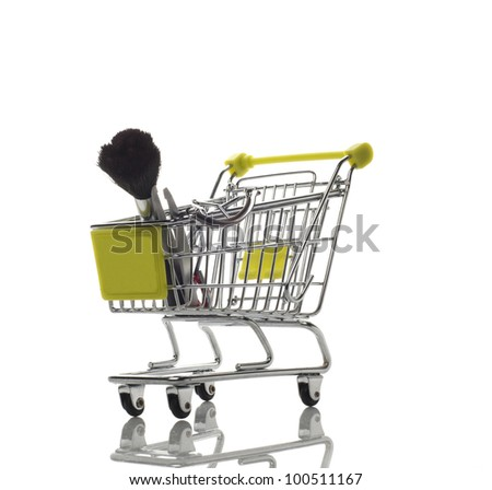 Green shopping cart with cosmetics isolated on white background with reflection