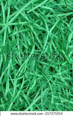 Green shredded paper as background, packaging material  - stock photo