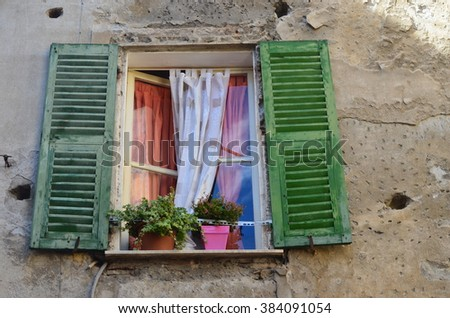 Green Shuttered Window Of An Old Stone House In Ventimiglia Italy.
