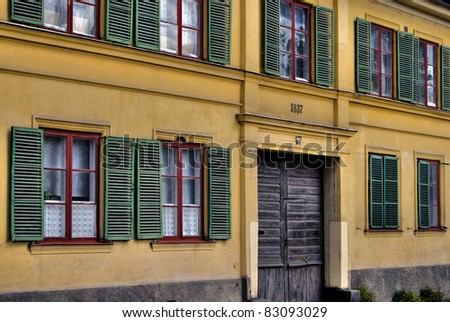 Green shutters on old facade from the nineteenth century