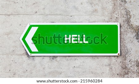 Green sign on a concrete wall - Hell - stock photo