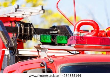 green siren on fire truck - stock photo