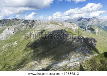 Green slopes of mountains in the Austrian Alps in a spring sunny day