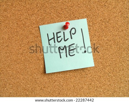 Green small sticky note on an office cork bulletin board. Help message. - stock photo