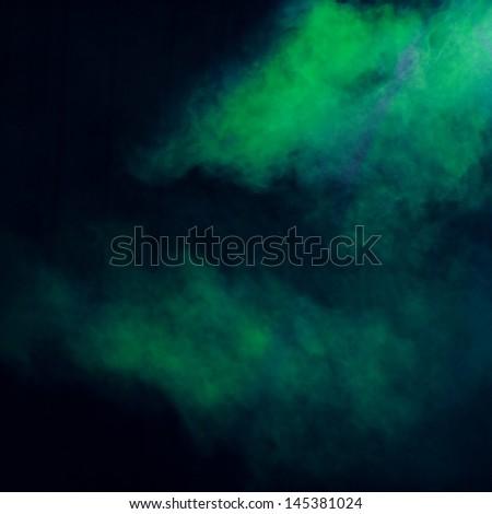 Green smoke effect on concert lighting/Image of green illumination on concert lighting a dark background - stock photo