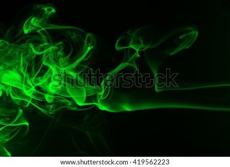 green smoke on black background, movement of green smoke, smoke background, darkness concept