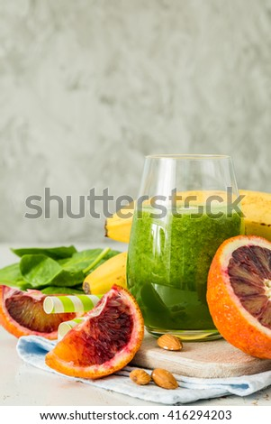 Green smoothie and ingredients, copy space, white background