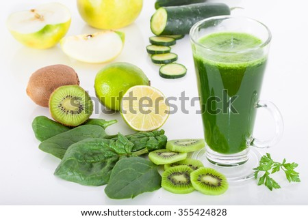 Green smoothie from spinach, kiwi, apple and cucumber, white background