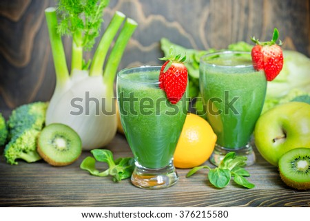 Green smoothie in our diet to boost immunity - stock photo