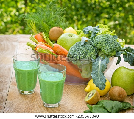 Green smoothie is refreshing and invigorating drink  - stock photo