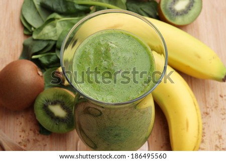 Green smoothie made with kiwi, spinach  and banana - stock photo