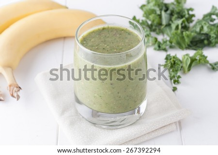 green smoothie on white background, ingredients include bananas, fresh kale and almonds - stock photo