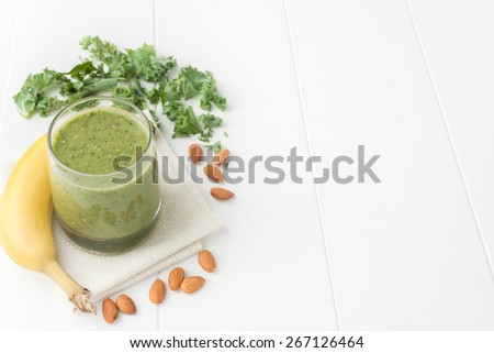 green smoothie on white background, ingredients include bananas, fresh kale and almonds, room for text - stock photo
