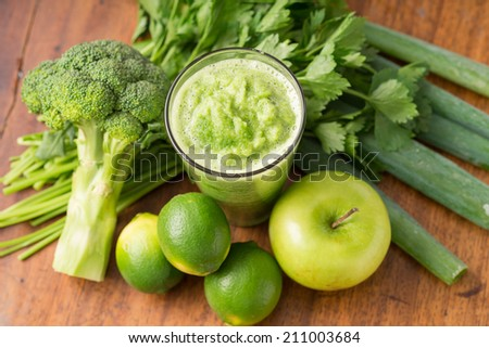 Green smoothie with apples, limes, leek, celery and broccoli, view from above - stock photo