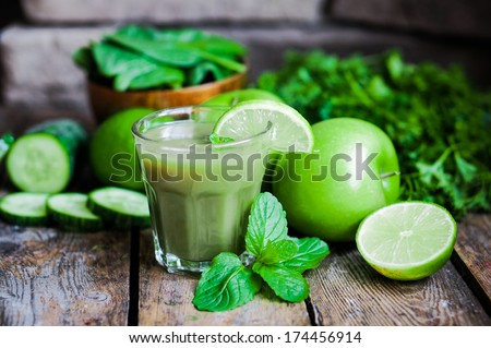 Green smoothie with apples,parsley,spinach,cucumber,lime and min - stock photo
