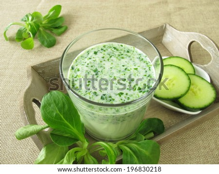 Green smoothie with corn salad and cucumber - stock photo