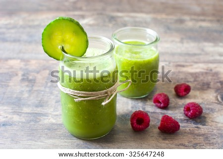 Green smoothie with cucumber and raspberry - stock photo
