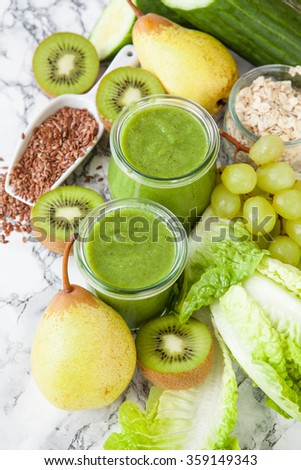 Green smoothie with fresh fruits and vegetables