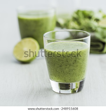 Green smoothie with ingredients - stock photo