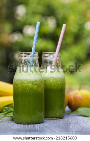 Green smoothie with spinach, apples and bananas - stock photo