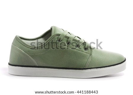green sneaker on a white background