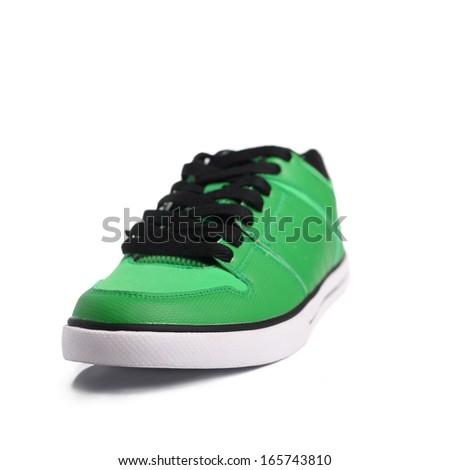 Green sneakers - stock photo