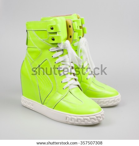 Green sneakers isolated on white - stock photo