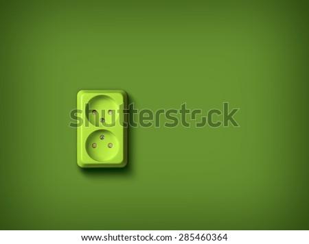 Green socket on green wall, renewable eco energy concept - stock photo