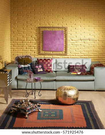 green sofa gold brick wall living room pillow and old rug with frame