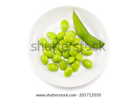 Green soybeans on white background - stock photo