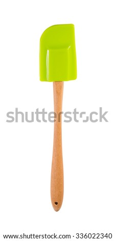 green spatula with wooden handle isolated on white - stock photo