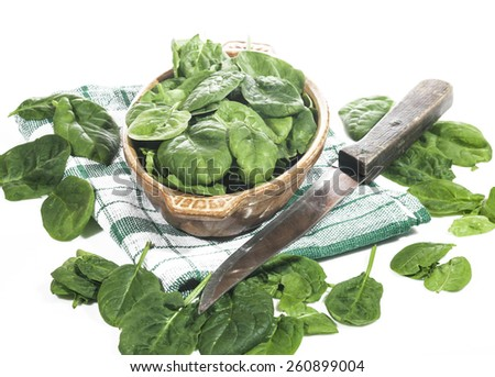 Green spinach in a bowl on a white background - stock photo