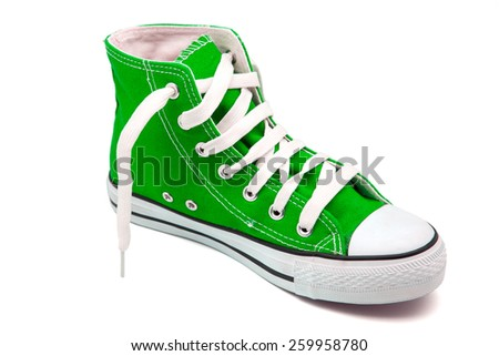 Green sports shoes  on white background - stock photo