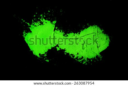 green spot on a black background, abstract - stock photo